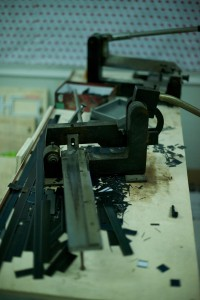 The die blades are clipped from long strips down to the precise length needed to go into the board.