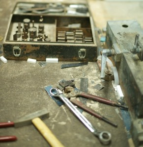 Hand tools are used to bend the die blades into shape for the boards.
