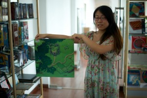 Here's Melinda showing one of those unusual game bits: a rubberized mat. You'll likely end up talking to Melinda. She has the best English of the crew I met at Lijia.